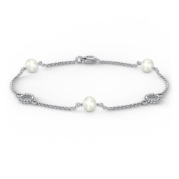 Sterling Silver and Pearl Bracelet with Twisted Ring Charms